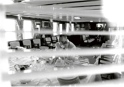 President Lyndon Baines Johnson hard at work seated at the buffet in the main salon.